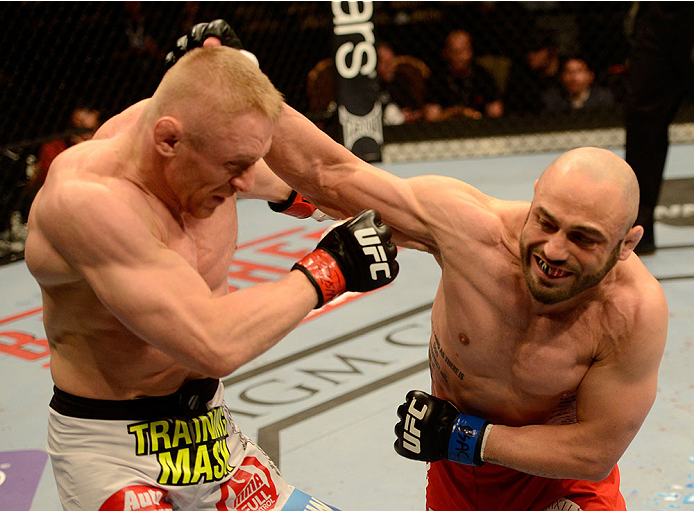 LAS VEGAS, NV - DECEMBER 28:  (R-L) Manny Gamburyan punches Dennis Siver in their featherweight bout during the UFC 168 event at the MGM Grand Garden Arena on December 28, 2013 in Las Vegas, Nevada. (Photo by Donald Miralle/Zuffa LLC/Zuffa LLC via Getty Images) *** Local Caption *** Dennis Siver; Manny Gamburyan