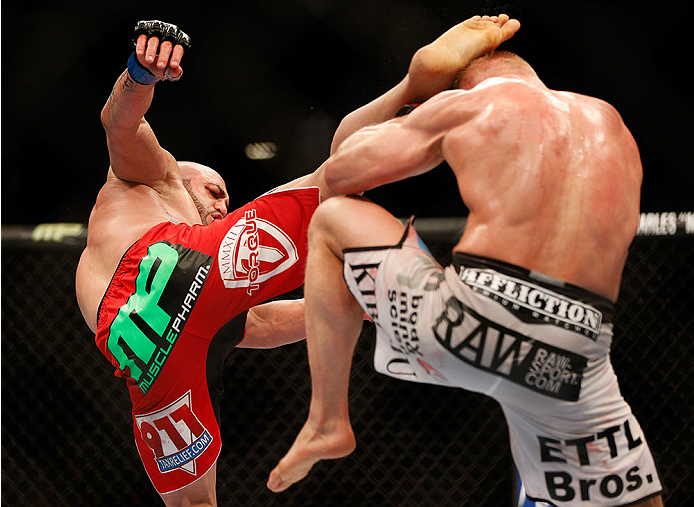 LAS VEGAS, NV - DECEMBER 28:  (L-R) Manny Gamburyan kicks Dennis Siver in their featherweight bout during the UFC 168 event at the MGM Grand Garden Arena on December 28, 2013 in Las Vegas, Nevada. (Photo by Josh Hedges/Zuffa LLC/Zuffa LLC via Getty Images) *** Local Caption *** Dennis Siver; Manny Gamburyan