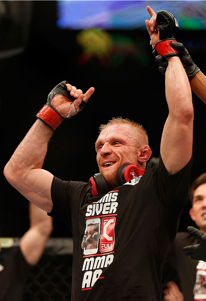 LAS VEGAS, NV - DECEMBER 28:  Dennis Siver reacts to his victory over Manny Gamburyan in their featherweight bout during the UFC 168 event at the MGM Grand Garden Arena on December 28, 2013 in Las Vegas, Nevada. (Photo by Josh Hedges/Zuffa LLC/Zuffa LLC via Getty Images) *** Local Caption *** Dennis Siver