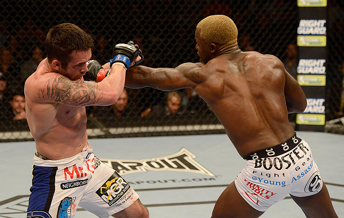 LAS VEGAS, NV - DECEMBER 29:  (R-L) Melvin Guillard punches Jamie Varner during their lightweight fight at UFC 155 on December 29, 2012 at MGM Grand Garden Arena in Las Vegas, Nevada. (Photo by Donald Miralle/Zuffa LLC/Zuffa LLC via Getty Images) *** Local Caption *** Melvin Guillard; Jamie Varner