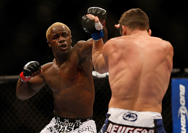 LAS VEGAS, NV - DECEMBER 29:  (L-R) Melvin Guillard punches Jamie Varner during their lightweight fight at UFC 155 on December 29, 2012 at MGM Grand Garden Arena in Las Vegas, Nevada. (Photo by Josh Hedges/Zuffa LLC/Zuffa LLC via Getty Images) *** Local Caption *** Melvin Guillard; Jamie Varner