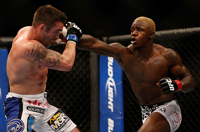 LAS VEGAS, NV - DECEMBER 29:  (R-L) Melvin Guillard punches Jamie Varner during their lightweight fight at UFC 155 on December 29, 2012 at MGM Grand Garden Arena in Las Vegas, Nevada. (Photo by Josh Hedges/Zuffa LLC/Zuffa LLC via Getty Images) *** Local Caption *** Melvin Guillard; Jamie Varner
