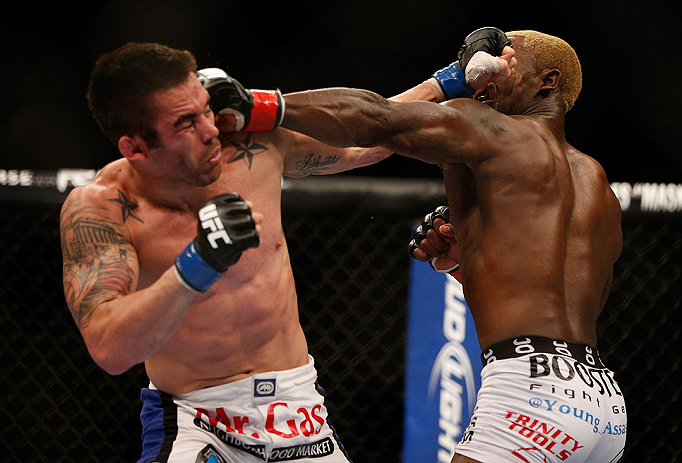 LAS VEGAS, NV - DECEMBER 29:  (L-R) Jamie Varner and Melvin Guillard exchange punches during their lightweight fight at UFC 155 on December 29, 2012 at MGM Grand Garden Arena in Las Vegas, Nevada. (Photo by Josh Hedges/Zuffa LLC/Zuffa LLC via Getty Images) *** Local Caption *** Melvin Guillard; Jamie Varner