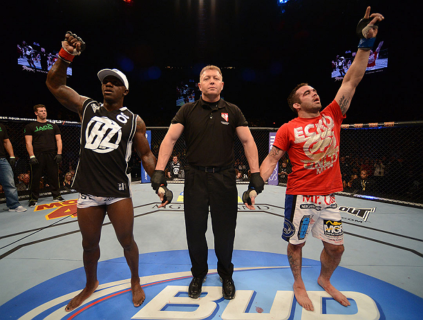 LAS VEGAS, NV - DECEMBER 29:  Melvin Guillard (left) and Jamie Varner (right) await the official decision after their lightweight fight at UFC 155 on December 29, 2012 at MGM Grand Garden Arena in Las Vegas, Nevada. (Photo by Donald Miralle/Zuffa LLC/Zuffa LLC via Getty Images) *** Local Caption *** Melvin Guillard; Jamie Varner