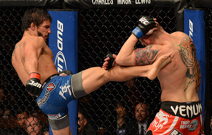 ANAHEIM, CA - FEBRUARY 23:  (L-R) Dennis Bermudez (left) kicks Matt Grice in their featherweight bout during UFC 157 at Honda Center on February 23, 2013 in Anaheim, California.  (Photo by Donald Miralle/Zuffa LLC/Zuffa LLC via Getty Images) *** Local Caption *** Dennis Bermudez; Matt Grice