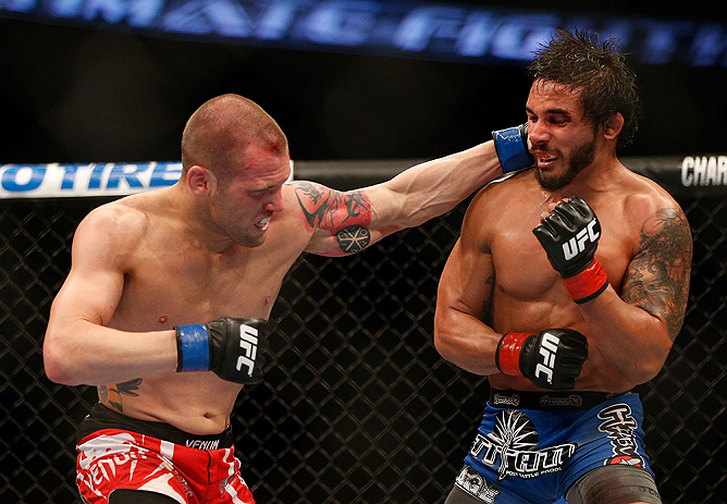 ANAHEIM, CA - FEBRUARY 23:  (L-R) Matt Grice punches Dennis Bermudez in their featherweight bout during UFC 157 at Honda Center on February 23, 2013 in Anaheim, California.  (Photo by Josh Hedges/Zuffa LLC/Zuffa LLC via Getty Images) *** Local Caption *** Dennis Bermudez; Matt Grice