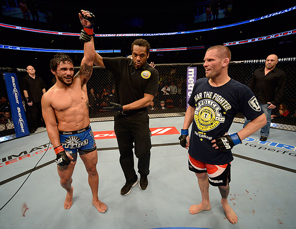 ANAHEIM, CA - FEBRUARY 23:  Dennis Bermudez (left) reacts to his victory over Matt Grice (right) in their featherweight bout during UFC 157 at Honda Center on February 23, 2013 in Anaheim, California.  (Photo by Donald Miralle/Zuffa LLC/Zuffa LLC via Getty Images) *** Local Caption *** Dennis Bermudez; Matt Grice
