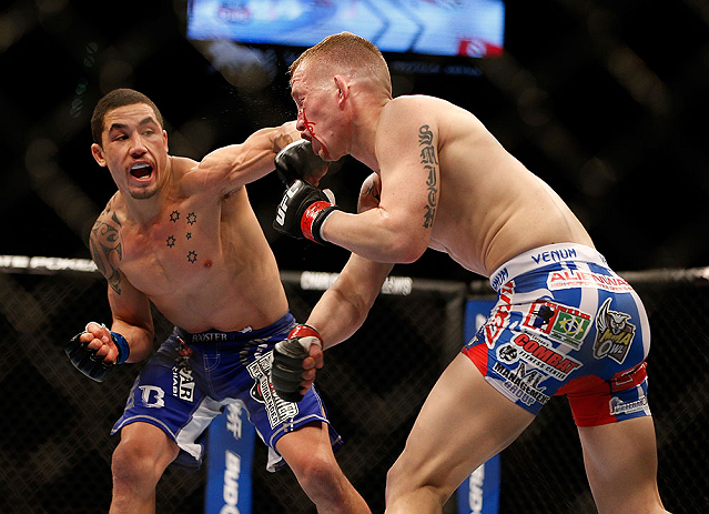 LAS VEGAS, NV - MAY 25:   (L-R) Robert Whittaker punches Colton Smith in their welterweight bout during UFC 160 at the MGM Grand Garden Arena on May 25, 2013 in Las Vegas, Nevada.  (Photo by Josh Hedges/Zuffa LLC/Zuffa LLC via Getty Images)  *** Local Caption *** Colton Smith; Robert Whittaker
