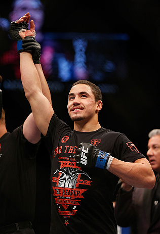 LAS VEGAS, NV - MAY 25:   Robert Whittaker reacts to his victory over Colton Smith in their welterweight bout during UFC 160 at the MGM Grand Garden Arena on May 25, 2013 in Las Vegas, Nevada.  (Photo by Josh Hedges/Zuffa LLC/Zuffa LLC via Getty Images)  *** Local Caption *** Colton Smith; Robert Whittaker
