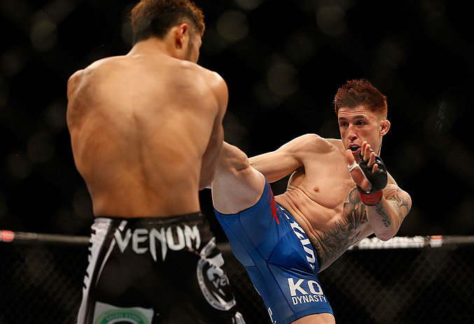 LAS VEGAS, NV - JULY 06:  (R-L) Norman Parke kicks Kazuki Tokudome in their lightweight fight during the UFC 162 event inside the MGM Grand Garden Arena on July 6, 2013 in Las Vegas, Nevada.  (Photo by Josh Hedges/Zuffa LLC/Zuffa LLC via Getty Images) *** Local Caption *** Norman Parke; Kazuki Tokudome