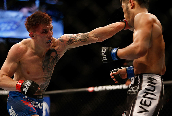 LAS VEGAS, NV - JULY 06:  (L-R) Norman Parke punches Kazuki Tokudome in their lightweight fight during the UFC 162 event inside the MGM Grand Garden Arena on July 6, 2013 in Las Vegas, Nevada.  (Photo by Josh Hedges/Zuffa LLC/Zuffa LLC via Getty Images) *** Local Caption *** Norman Parke; Kazuki Tokudome