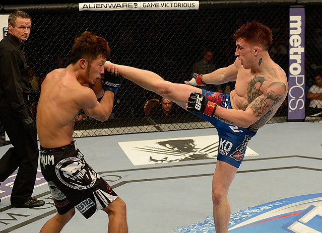 LAS VEGAS, NV - JULY 06:  (R-L) Norman Parke kicks Kazuki Tokudome in their lightweight fight during the UFC 162 event inside the MGM Grand Garden Arena on July 6, 2013 in Las Vegas, Nevada.  (Photo by Donald Miralle/Zuffa LLC/Zuffa LLC via Getty Images) *** Local Caption *** Norman Parke; Kazuki Tokudome