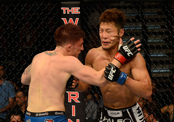 LAS VEGAS, NV - JULY 06:  (L-R) Norman Parke punches Kazuki Tokudome in their lightweight fight during the UFC 162 event inside the MGM Grand Garden Arena on July 6, 2013 in Las Vegas, Nevada.  (Photo by Donald Miralle/Zuffa LLC/Zuffa LLC via Getty Images) *** Local Caption *** Norman Parke; Kazuki Tokudome