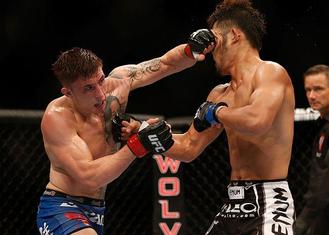 LAS VEGAS, NV - JULY 06:  Norman Parke  (left) punches Kazuki Tokudome in their lightweight fight during the UFC 162 event inside the MGM Grand Garden Arena on July 6, 2013 in Las Vegas, Nevada.  (Photo by Josh Hedges/Zuffa LLC/Zuffa LLC via Getty Images) *** Local Caption *** Norman Parke; Kazuki Tokudome