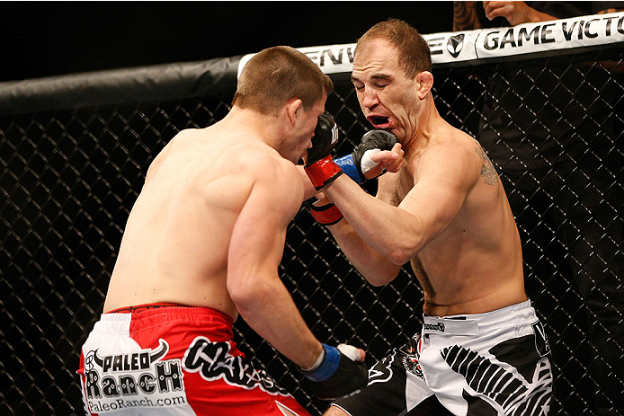 LAS VEGAS, NV - NOVEMBER 16:  (L-R) Rick Story punches Brian Ebersole in their welterweight bout during the UFC 167 event inside the MGM Grand Garden Arena on November 16, 2013 in Las Vegas, Nevada. (Photo by Josh Hedges/Zuffa LLC/Zuffa LLC via Getty Images) *** Local Caption *** Brian Ebersole; Rick Story