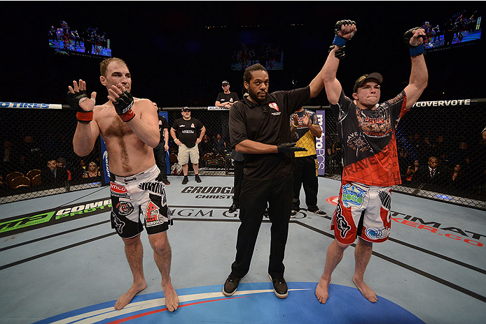 LAS VEGAS, NV - NOVEMBER 16:  Rick Story (right) is declared the winner over Brian Ebersole (left) in their welterweight bout during the UFC 167 event inside the MGM Grand Garden Arena on November 16, 2013 in Las Vegas, Nevada. (Photo by Donald Miralle/Zuffa LLC/Zuffa LLC via Getty Images) *** Local Caption *** Brian Ebersole; Rick Story