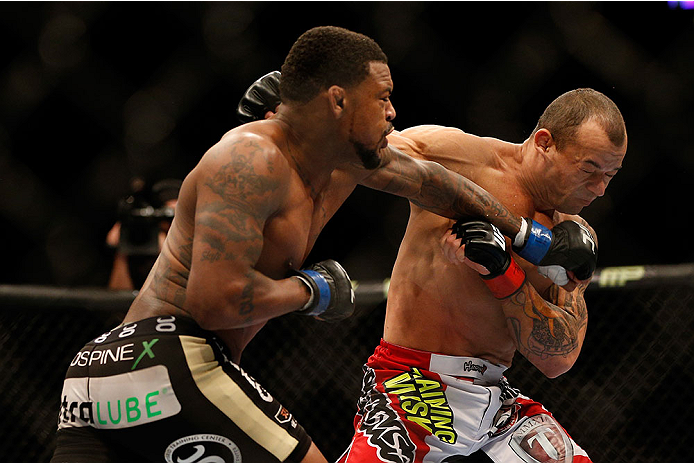 LAS VEGAS, NV - DECEMBER 28:  (L-R) Michael Johnson punches Gleison Tibau in their lightweight bout during the UFC 168 event at the MGM Grand Garden Arena on December 28, 2013 in Las Vegas, Nevada. (Photo by Josh Hedges/Zuffa LLC/Zuffa LLC via Getty Images) *** Local Caption *** Gleison Tibau; Michael Johnson