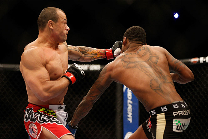 LAS VEGAS, NV - DECEMBER 28:  (L-R) Gleison Tibau punches Michael Johnson in their lightweight bout during the UFC 168 event at the MGM Grand Garden Arena on December 28, 2013 in Las Vegas, Nevada. (Photo by Josh Hedges/Zuffa LLC/Zuffa LLC via Getty Images) *** Local Caption *** Gleison Tibau; Michael Johnson