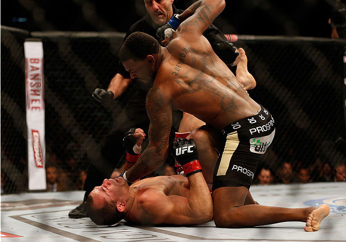 LAS VEGAS, NV - DECEMBER 28:  Michael Johnson (top) punches Gleison Tibau in their lightweight bout during the UFC 168 event at the MGM Grand Garden Arena on December 28, 2013 in Las Vegas, Nevada. (Photo by Josh Hedges/Zuffa LLC/Zuffa LLC via Getty Images) *** Local Caption *** Gleison Tibau; Michael Johnson