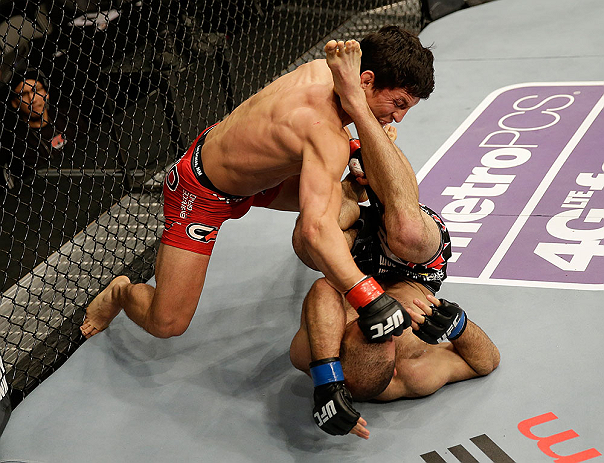 SAN JOSE, CA - APRIL 20:   Joseph Benavidez (top) punches Darren Uyenoyama in their flyweight bout during the UFC on FOX event at the HP Pavilion on April 20, 2013 in San Jose, California.  (Photo by Ezra Shaw/Zuffa LLC/Zuffa LLC via Getty Images)  *** Local Caption *** Joseph Benavidez; Darren Uyenoyama