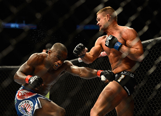 SEATTLE, WA - JULY 27:  (R-L) Daron Cruickshank punches Yves Edwards in their lightweight bout during the UFC on FOX event at Key Arena on July 27, 2013 in Seattle, Washington. (Photo by Jeff Bottari/Zuffa LLC/Zuffa LLC via Getty Images) *** Local Caption *** Yves Edwards; Daron Cruickshank