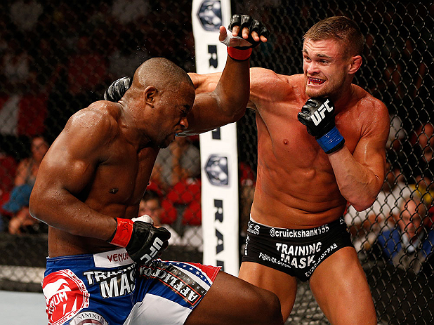 SEATTLE, WA - JULY 27:  (R-L) Daron Cruickshank punches Yves Edwards in their lightweight bout during the UFC on FOX event at Key Arena on July 27, 2013 in Seattle, Washington. (Photo by Josh Hedges/Zuffa LLC/Zuffa LLC via Getty Images) *** Local Caption *** Yves Edwards; Daron Cruickshank
