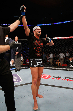 SEATTLE, WA - JULY 27:  Daron Cruickshank reacts after his lightweight bout against Yves Edwards during the UFC on FOX event at Key Arena on July 27, 2013 in Seattle, Washington. (Photo by Josh Hedges/Zuffa LLC/Zuffa LLC via Getty Images) *** Local Caption ***  Daron Cruickshank