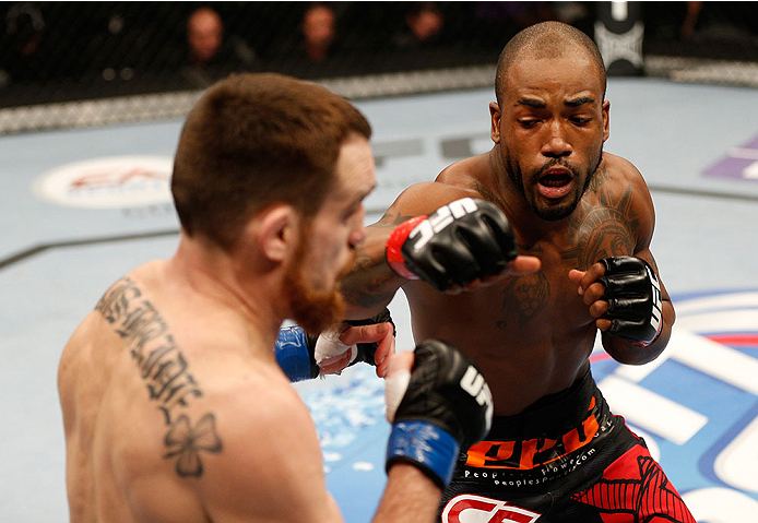 SACRAMENTO, CA - DECEMBER 14:  (R-L) Bobby Green punches Pat Healy in their lightweight bout during the UFC on FOX event at Sleep Train Arena on December 14, 2013 in Sacramento, California. (Photo by Josh Hedges/Zuffa LLC/Zuffa LLC via Getty Images) *** Local Caption *** Bobby Green; Pat Healy