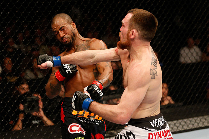 SACRAMENTO, CA - DECEMBER 14:  (R-L) Pat Healy punches Bobby Green in their lightweight bout during the UFC on FOX event at Sleep Train Arena on December 14, 2013 in Sacramento, California. (Photo by Josh Hedges/Zuffa LLC/Zuffa LLC via Getty Images) *** Local Caption *** Bobby Green; Pat Healy