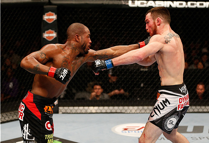 SACRAMENTO, CA - DECEMBER 14:  (L-R) Bobby Green punches Pat Healy in their lightweight bout during the UFC on FOX event at Sleep Train Arena on December 14, 2013 in Sacramento, California. (Photo by Josh Hedges/Zuffa LLC/Zuffa LLC via Getty Images) *** Local Caption *** Bobby Green; Pat Healy