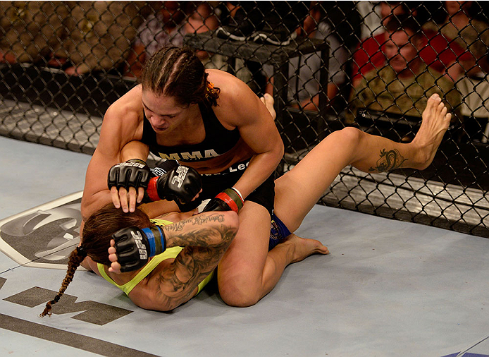FORT CAMPBELL, KENTUCKY - NOVEMBER 6:  Amanda Nunes (top) elbows Germaine de Randamie in their UFC women's bantamweight bout on November 6, 2013 in Fort Campbell, Kentucky. (Photo by Jeff Bottari/Zuffa LLC/Zuffa LLC via Getty Images) *** Local Caption ***Amanda Nunes; Germaine de Randamie
