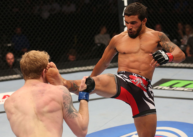 DENVER, CO - AUGUST 11:  (R-L) Dennis Bermudez kicks Tommy Hayden during their featherweight bout at UFC 150 inside Pepsi Center on August 11, 2012 in Denver, Colorado. (Photo by Nick Laham/Zuffa LLC/Zuffa LLC via Getty Images)