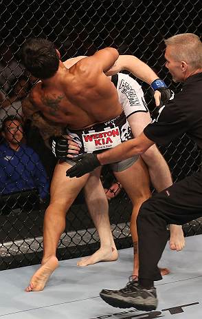 DENVER, CO - AUGUST 11:  (L-R) Dennis Bermudez submits Tom Hayden with a guillotine choke during their featherweight bout at UFC 150 inside Pepsi Center on August 11, 2012 in Denver, Colorado. (Photo by Nick Laham/Zuffa LLC/Zuffa LLC via Getty Images)