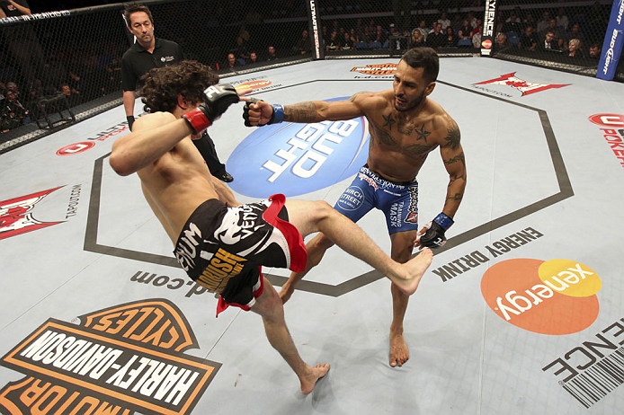 CALGARY, CANADA - JULY 21:  (R-L) Francisco Rivera lands a punch to the head of Roland Delorme during their bantamweight bout at UFC 149 inside the Scotiabank Saddledome on July 21, 2012 in Calgary, Alberta, Canada.  (Photo by Nick Laham/Zuffa LLC/Zuffa LLC via Getty Images)