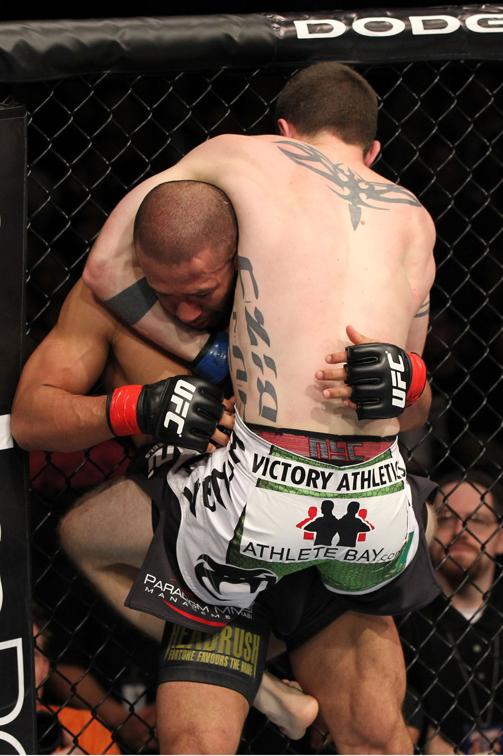 OMAHA, NE - FEBRUARY 15:  (R-L) John Albert attempts a guillotine choke submission against Ivan Menjivar during the UFC on FUEL TV event at Omaha Civic Auditorium on February 15, 2012 in Omaha, Nebraska.  (Photo by Josh Hedges/Zuffa LLC/Zuffa LLC via Getty Images) *** Local Caption *** Ivan Menjivar; John Albert