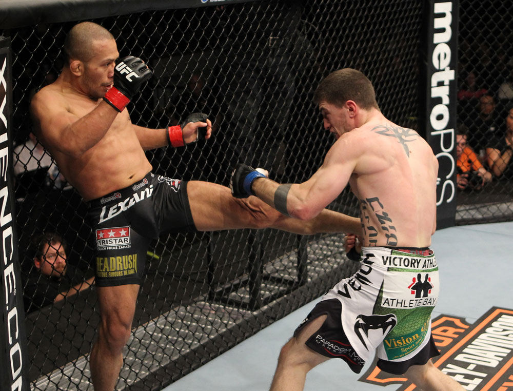 OMAHA, NE - FEBRUARY 15:  (L-R) Ivan Menjivar kicks John Albert during the UFC on FUEL TV event at Omaha Civic Auditorium on February 15, 2012 in Omaha, Nebraska.  (Photo by Josh Hedges/Zuffa LLC/Zuffa LLC via Getty Images) *** Local Caption *** Ivan Menjivar; John Albert