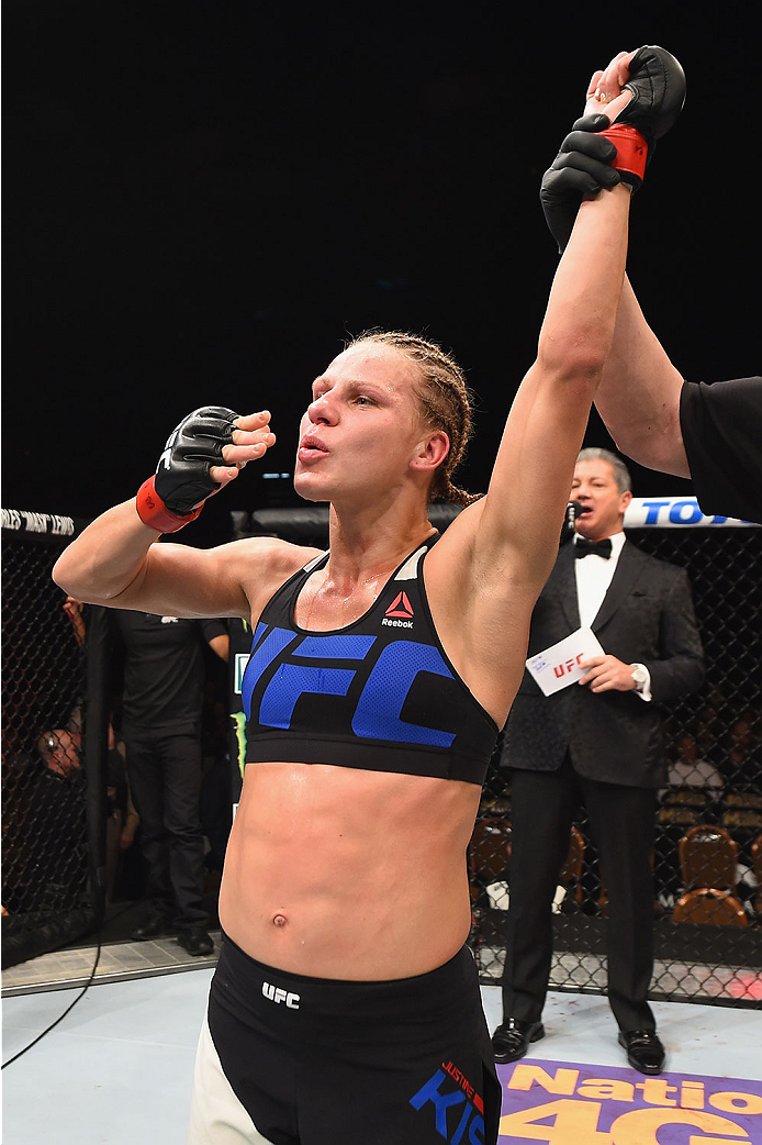 Justine Kish reacts to her victory over <a href='../fighter/nina-ansaroff'>Nina Ansaroff</a> during their bout at UFC 195