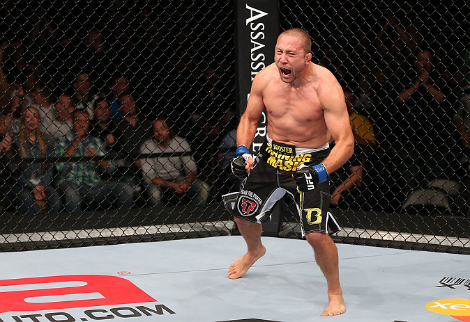 MINNEAPOLIS, MN - OCTOBER 05:  Mike Pierce reacts after knocking out Aaron Simpson during their welterweight fight at the UFC on FX event at Target Center on October 5, 2012 in Minneapolis, Minnesota.  (Photo by Josh Hedges/Zuffa LLC/Zuffa LLC via Getty Images)