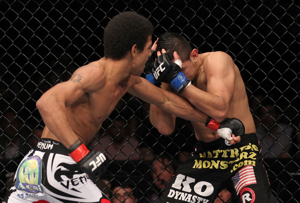 LAS VEGAS, NV - FEBRUARY 04:  Alex Caceres (left) punches Edwin Figueroa during the UFC 143 event at Mandalay Bay Events Center on February 4, 2012 in Las Vegas, Nevada.  (Photo by Nick Laham/Zuffa LLC/Zuffa LLC via Getty Images) *** Local Caption *** Alex Caceres; Edwin Figueroa
