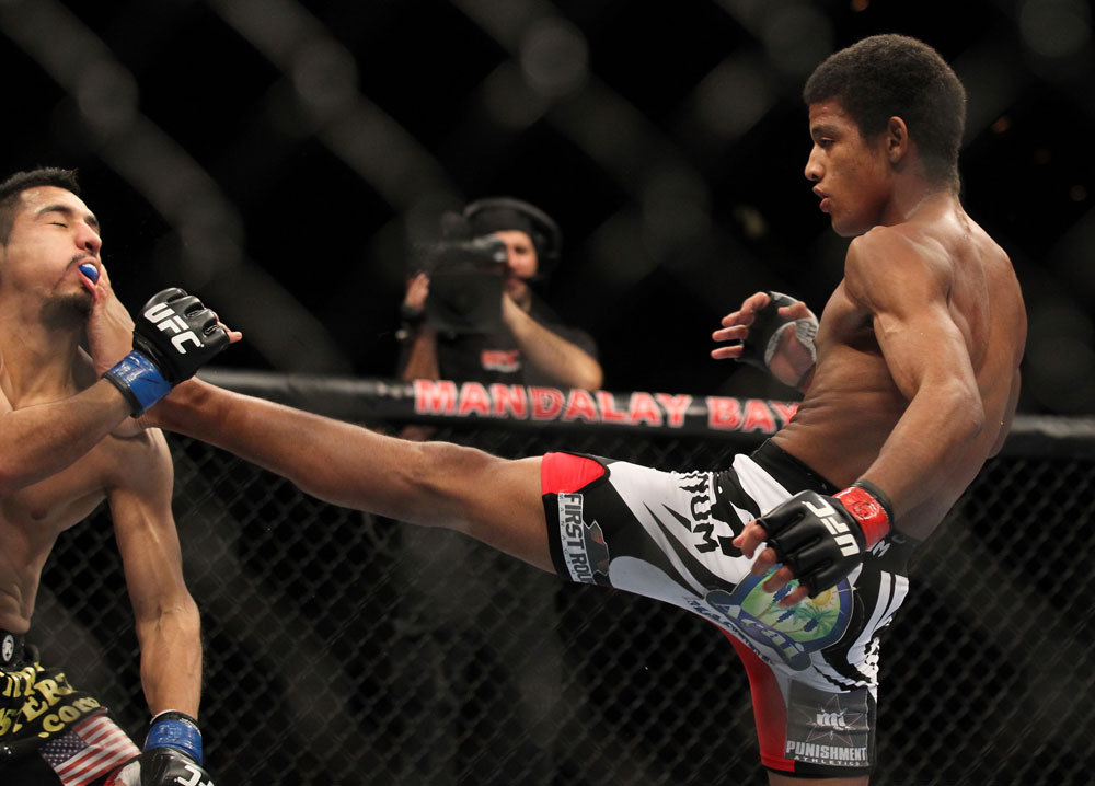 LAS VEGAS, NV - FEBRUARY 04:  Alex Caceres (right) kicks Edwin Figueroa during the UFC 143 event at Mandalay Bay Events Center on February 4, 2012 in Las Vegas, Nevada.  (Photo by Josh Hedges/Zuffa LLC/Zuffa LLC via Getty Images) *** Local Caption *** Alex Caceres; Edwin Figueroa