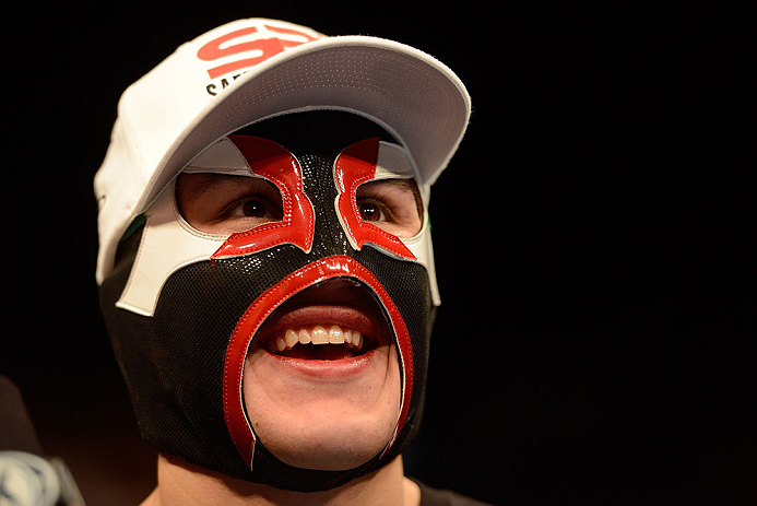 LAS VEGAS, NV - DECEMBER 29:  Erik Perez wearing a lucha libre mask after his victory over Byron Bloodworth at UFC 155 on December 29, 2012 at MGM Grand Garden Arena in Las Vegas, Nevada. (Photo by Donald Miralle/Zuffa LLC/Zuffa LLC via Getty Images) *** Local Caption *** Erik Perez; Byron Bloodworth