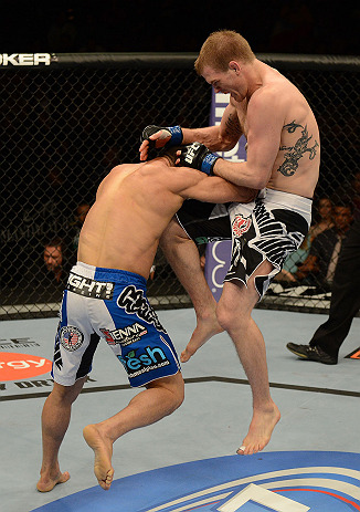 LAS VEGAS, NV - FEBRUARY 02:  (R-L) Evan Dunham knees Gleison Tibau during their lightweight fight at UFC 156 on February 2, 2013 at the Mandalay Bay Events Center in Las Vegas, Nevada.  (Photo by Donald Miralle/Zuffa LLC/Zuffa LLC via Getty Images) *** Local Caption *** Gleison Tibau; Evan Dunham