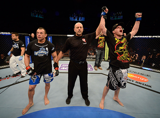 LAS VEGAS, NV - FEBRUARY 02:  Evan Dunham (right) reacts to his victory over Gleison Tibau after their lightweight fight at UFC 156 on February 2, 2013 at the Mandalay Bay Events Center in Las Vegas, Nevada.  (Photo by Donald Miralle/Zuffa LLC/Zuffa LLC via Getty Images) *** Local Caption *** Gleison Tibau; Evan Dunham