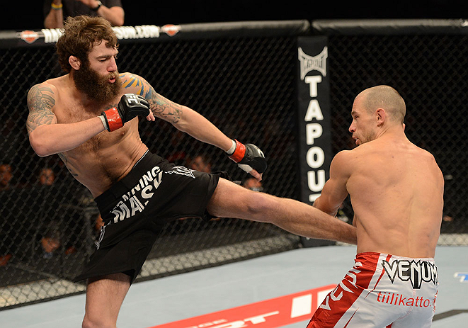 ANAHEIM, CA - FEBRUARY 23:  (L-R) Michael Chiesa kicks Anton Kuivanen in their lightweight bout during UFC 157 at Honda Center on February 23, 2013 in Anaheim, California.  (Photo by Donald Miralle/Zuffa LLC/Zuffa LLC via Getty Images) *** Local Caption *** Michael Chiesa; Anton Kuivanen