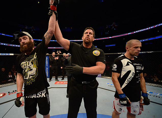 ANAHEIM, CA - FEBRUARY 23:  Michael Chiesa (left) is named the winner over Anton Kuivanen (right) after their lightweight bout during UFC 157 at Honda Center on February 23, 2013 in Anaheim, California.  (Photo by Donald Miralle/Zuffa LLC/Zuffa LLC via Getty Images) *** Local Caption *** Michael Chiesa; Anton Kuivanen