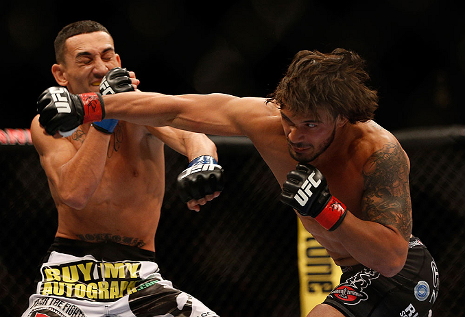 LAS VEGAS, NV - MAY 25:   (R-L) Dennis Bermudez punches Max Holloway in their featherweight bout during UFC 160 at the MGM Grand Garden Arena on May 25, 2013 in Las Vegas, Nevada.  (Photo by Josh Hedges/Zuffa LLC/Zuffa LLC via Getty Images)  *** Local Caption *** Dennis Bermudez; Max Holloway