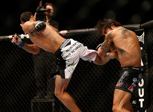 LAS VEGAS, NV - MAY 25:   (L-R) Max Holloway kicks Dennis Bermudez in their featherweight bout during UFC 160 at the MGM Grand Garden Arena on May 25, 2013 in Las Vegas, Nevada.  (Photo by Josh Hedges/Zuffa LLC/Zuffa LLC via Getty Images)  *** Local Caption *** Dennis Bermudez; Max Holloway