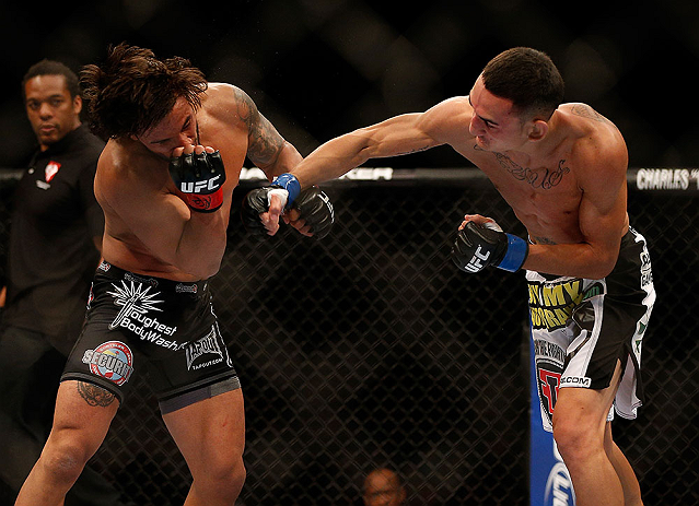 LAS VEGAS, NV - MAY 25:   (R-L) Max Holloway punches Dennis Bermudez in their featherweight bout during UFC 160 at the MGM Grand Garden Arena on May 25, 2013 in Las Vegas, Nevada.  (Photo by Josh Hedges/Zuffa LLC/Zuffa LLC via Getty Images)  *** Local Caption *** Dennis Bermudez; Max Holloway
