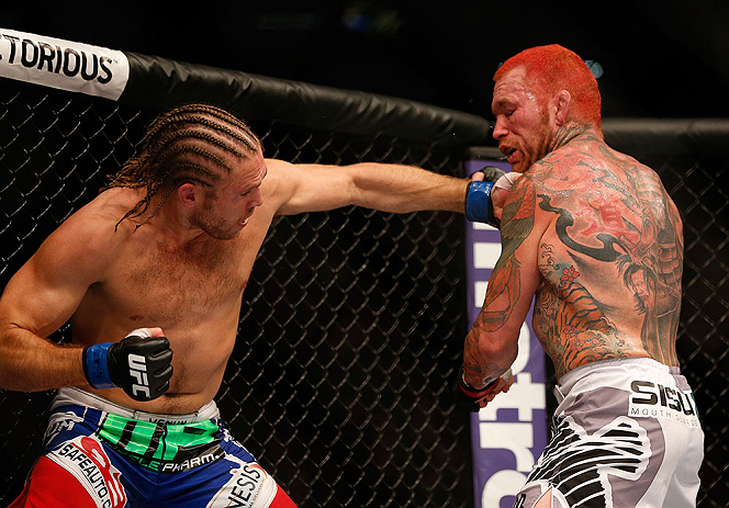LAS VEGAS, NV - JULY 06:  (L-R) Andrew Craig punches Chris Leben in their middleweight fight during the UFC 162 event inside the MGM Grand Garden Arena on July 6, 2013 in Las Vegas, Nevada.  (Photo by Josh Hedges/Zuffa LLC/Zuffa LLC via Getty Images) *** Local Caption *** Chris Leben; Andrew Craig