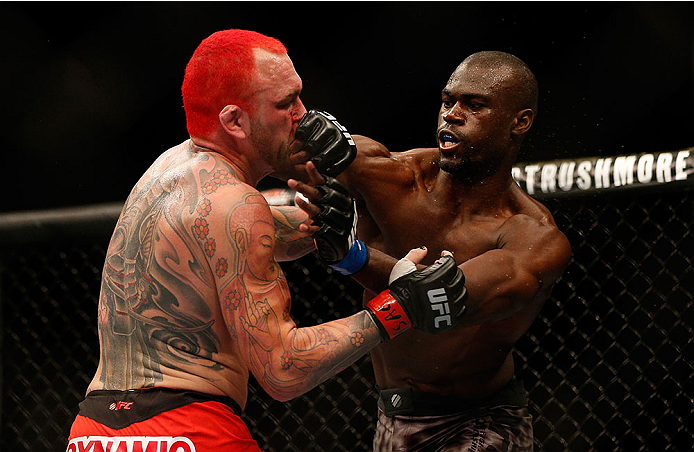 LAS VEGAS, NV - DECEMBER 28:  (R-L) Uriah Hall punches Chris Leben in their middleweight bout during the UFC 168 event at the MGM Grand Garden Arena on December 28, 2013 in Las Vegas, Nevada. (Photo by Josh Hedges/Zuffa LLC/Zuffa LLC via Getty Images) *** Local Caption *** Chris Leben; Uriah Hall